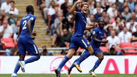 Chelsea's Marcos Alonso (centre) celebrates scoring his side's first goal of the game during the Pre