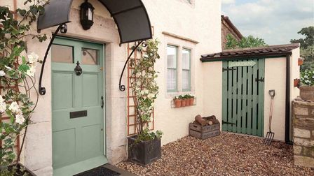 A country-style home painted in Dulux Weathershield paint