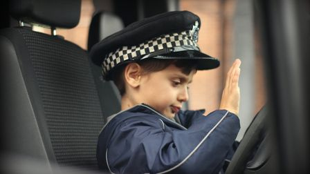 A youngster experiences what it's like behind the wheel of a police car during an open day at Hornse