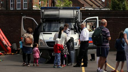 Visitors look over a police van. Picture: Nadia Stomina