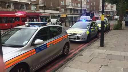 Several police cars attend the death of an infant at Harben Parade, Finchley Road. Photo: Josh Kirby