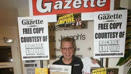 Rick Oughton hands out free copies of the Hackney Gazette at the St Joseph's Hospice Summer Fete in