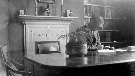 T.S. Eliot in his home at Crawford Mansions