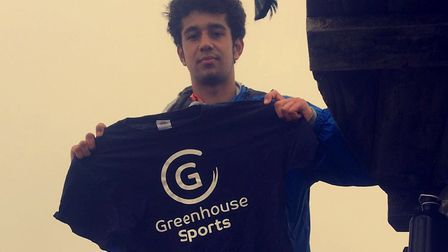 Marley Silcott with a Greenhouse Sports t-shirt. The group has raised nearly �1,000 for the charity.