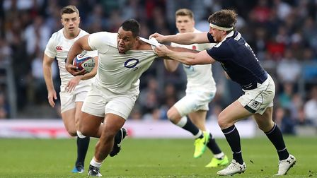 England's Billy Vunipola (left) holds off Scotland's Hamish Watson during the RBS Six Nations match