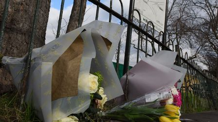 Flowers at the scene of the crash that killed Lewis Johnson in 2016. Picture: Ken Mears