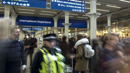 A file image of passengers and police near the Eurostar terminal at St Pancras International station