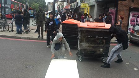 Protesters block the road outside Yours Locally in Dalston. Picture: Emma Bartholomew