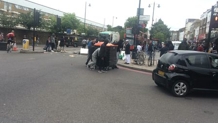 A protest outside Yours Locally in Dalston, where Rashan Charles was tackled by police shortly befor