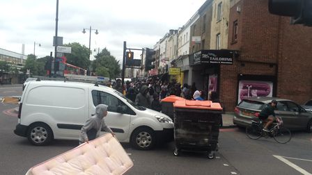 Boys in masks and hoods block Middleton Road with a wheelie bin. Picture: Emma Bartholomew