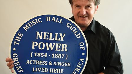 Music Hall Guild founder and director Adrian Barry with Nelly Power's blue plaque. Picture: The Musi