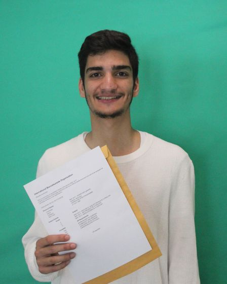 Westminster Academy student Abdulaziz Ibrahim with his results.