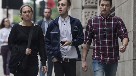 Charlie Alliston, 20 (centre), arrives at the Old Bailey in London today. Picture: Lauren Hurley/PA