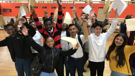 The Bridge Academy students receiving their GCSE results.