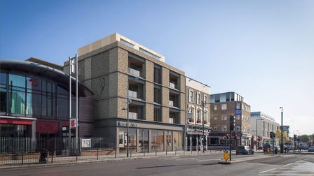 The new development of 19 houses on Haverstock Hill will be completed in 2018