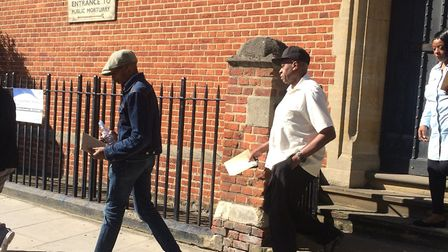 Rashan Charles' father, great uncle and a family friend leave Poplar Coroner's Court after the openi