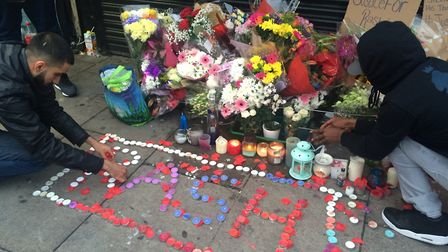 The vigil for Rashan outside the Yours Locally shop in Kingsland High Street. Picture: Emma Bartholo