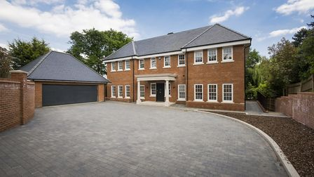 The larger of the Hadley Wood homes includes a luxurious swimming pool and large garden