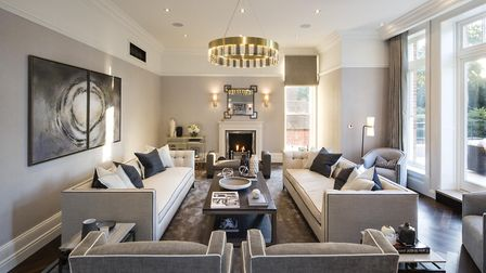 In addition to three formal reception rooms and two family rooms, the home also has a cinema/media r