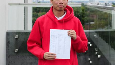 UCL Academy student John Kong collecting his A-level results. Credit: UCL Academy