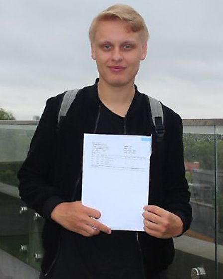UCL Academy student Lachlan Cotter collecting his A-level results. Credit: UCL Academy