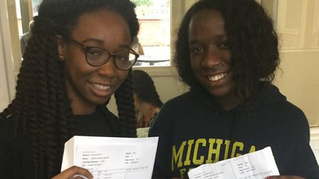 Hayley Obioma and Tofunmi Kayode collecting their results at Hackney's Cardinal Pole Catholic School