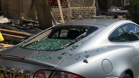 Jaguar's window damaged when high winds blew scaffolding off All Hallow's Church (Picture: Nathan Lo