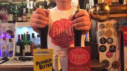Andy Skene pulling pints at his bar, the Queen Street Brewhouse in Colchester. Picture: Pitfield Bre