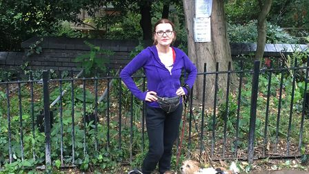 Kiki Kendrick stands in front of one of the trees earmarked by the council for removal Picture: Nath