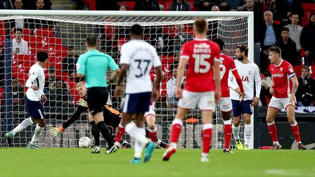 Tottenham Hotspur's Dele Alli (left) scores his side's first goal of the game during the Carabao Cup