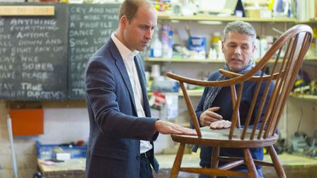 The Duke of Cambridge in the Restoration Station workshop with volunteer and former client Bernard B