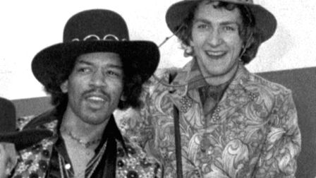 Jimi Hendrix and Mitch Mitchell about to board a plane at Heathrow Airport in 1968. Picture: PA Arch