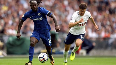 Chelsea's Victor Moses (left) and Tottenham Hotspur's Ben Davies battle for the ball during the Prem