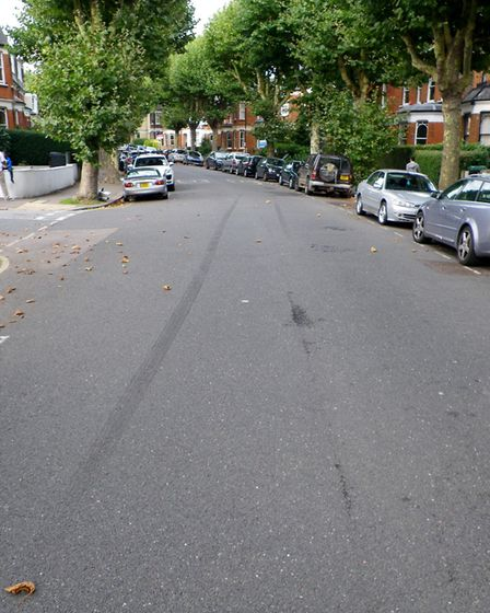 Skid marks along Stapleton Hall Road where the collision between a Mazda MX-5 and Toyota Prius happe