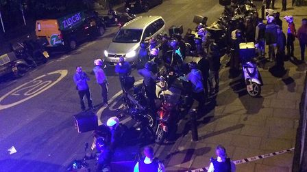Deliveroo and UberEATS drivers after the attack in Haggerston. Picture: @sarah_cobbold/PA Wire