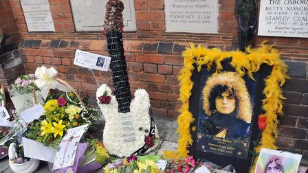 Flower tributes to Marc Bolan at Golders Green Crematorium to mark the 35th anniversary of his death
