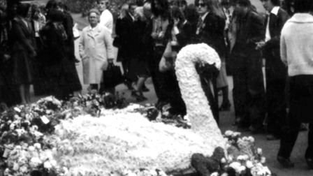 A giant white swan at Marc Bolan's funeral, Golders Green Crematorium, September 1977. Picture: Pres