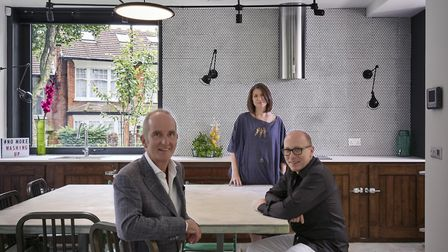 Presenter Kevin Mcloud with Penny and Mark in the kitchen of their Muswell Hill home