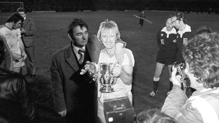 Nottingham Forest manager Brian Clough puts his arm round Kenny Burns as he proudly holds the 1978 L