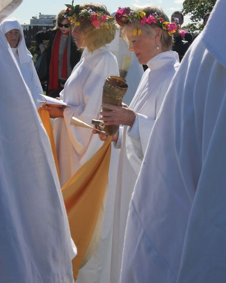 A druid holds a ceremonial flask of wine, which was offered to the earth during the celebration. Pic