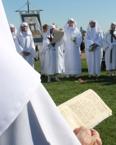 A list of deceased group members is read during the ceremony. Picture: EMILY HISLOP