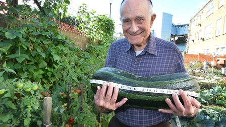 David Joseph, 80, with his 25 inch marrow in his garden in Poulton Close. Picture: Polly Hancock