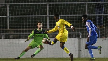AFC Wimbledon's Toyosi Olosamya scores the first goal during their London Senior Cup tie at Redbridg