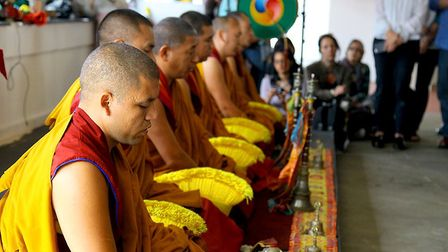 Buddhist monks from the Dalai Lama's monastery bless the Hive in a ceremony