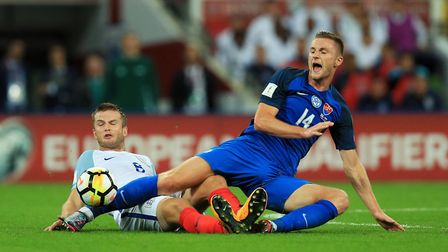 Slovakia's Milan Skriniar (left) is challenged by England's Eric Dier during the 2018 FIFA World Cup