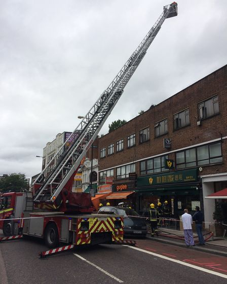 Southbound lanes of the Finchley Road closed while firefighters brought the fire under control. Pict