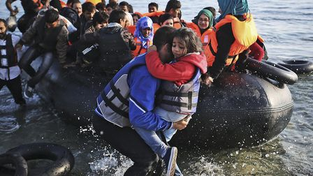 Syrian refugees come in on a boat from Turkey. Credit: Tara Todras-Whitehill for IRC