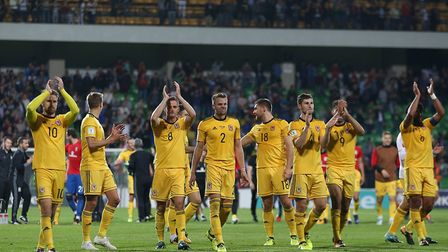Wales' players, including Tottenham Hotspur's Ben Davies, applaud supporters after the final whistle