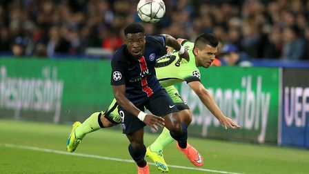 Manchester City's Sergio Aguero (right) and Paris Saint-Germain's Serge Aurier in action during the
