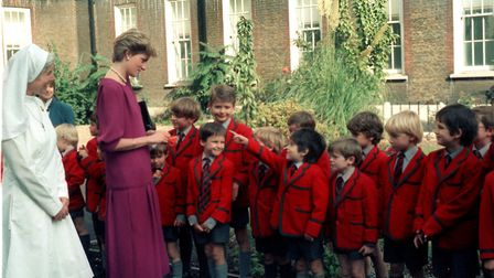 Princess Diana meets boys fron Arnold House School in St John's Wood on a visit in 1987. Picture: Ni